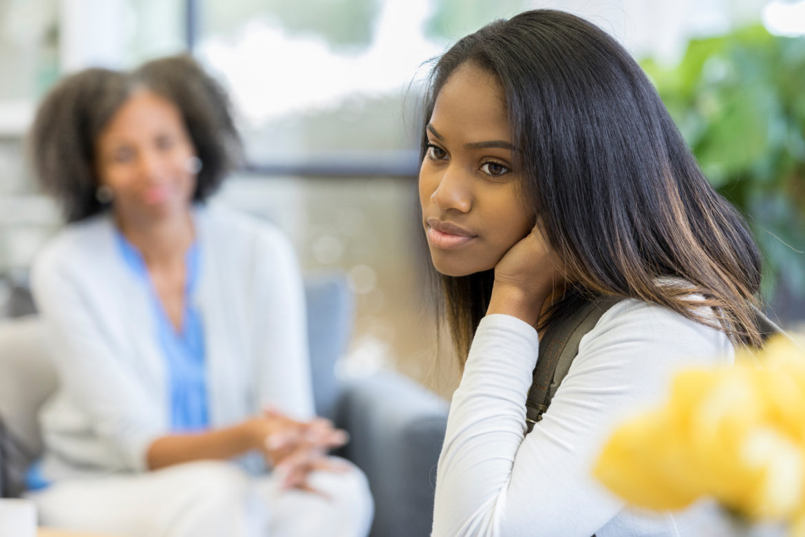 Image of a woman speaking with a teenage girl.
